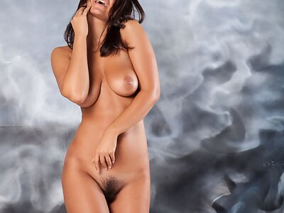 Busty brunette spreads her hairy pussy