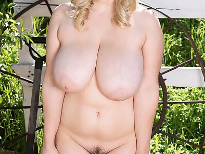 Chubby busty blonde shows off her hairy pussy
