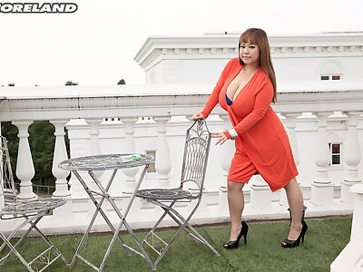 Chubby Asian shows off her huge tits