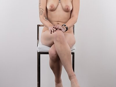 Casting pics of a tattooed amateur with large areolas