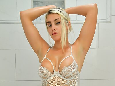 Busty blonde fisting in the shower