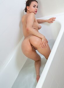 Sexy brunette with big pussy lips bathing