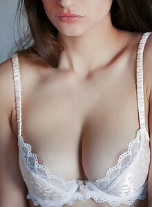 Busty brunette babe takes off her lingerie