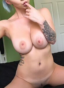 Blue-haired girl shows off her big lopsided boobs
