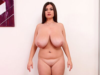 Busty brunette plays with ropes and plastic wrap