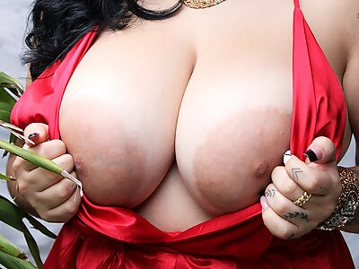 Chubby Latina shows off her huge tits and pancake areolas