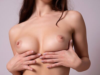 Brunette with big tits exposes her meaty pussy