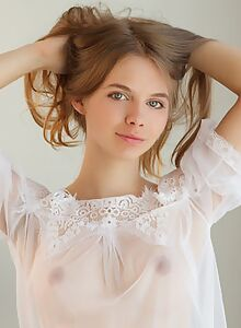 Cute teen with amazing eyes takes off her jean shorts