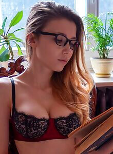 Nerdy Mila Azul takes off her lingerie