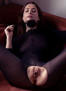 Busty brunette fingering her meaty pussy