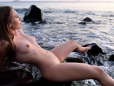 Sexy girl nude by the sea