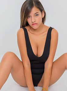 Busty exotic girl takes off her bodysuit