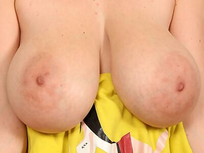 Busty girl with huge areolas stripping