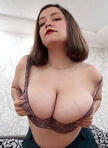 Busty brunette with huge saucer nipples masturbating