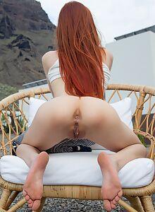Skinny redhead takes off her jean shorts to masturbate