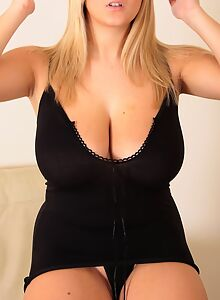 Chubby blonde shows off her big boobs