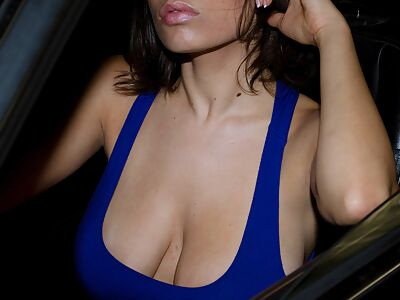 Busty brunette babe flashing in a car