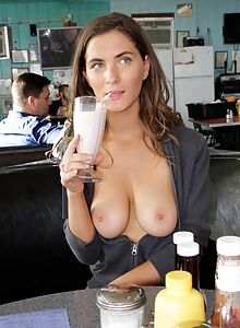 Brunette flashes her big tits in a restaurant