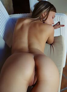 Sexy blue-eyed blonde nude on the couch
