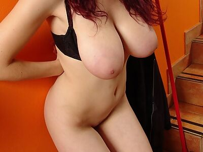 Busty brunette with big tits shows off her saucer nipples