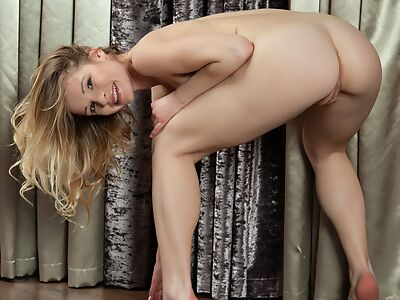 Shaved blonde with pale skin posing nude