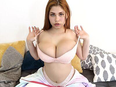 Curvy redhead Latina shows off her perfect big tits