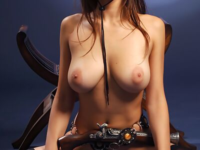 Gorgeous busty cowgirl posing nude