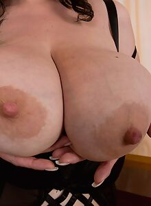 Chubby brunette shows off her massive saggy tits