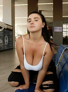 Chubby black-haired girl flashes her big boobs