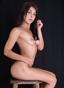 Cute brunette with saucer nipples stripping on a stool