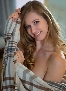 Curvy blonde babe Stella Cardo showing off her sexiness on the couch
