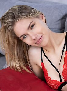 Cute blonde with firm tits takes off her red lingerie