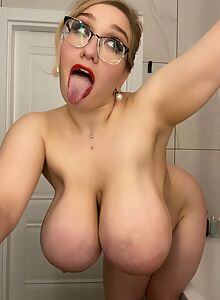 Nerdy blonde bbw shows off her huge pancake areolas