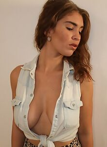 Busty brunette in a revealing cleavage