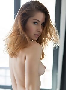Pale blonde girl stripping and posing