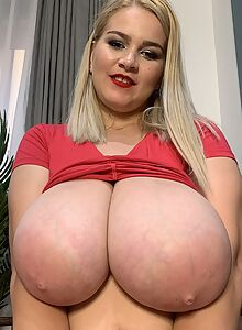 Chubby blonde shows off her enormous tits