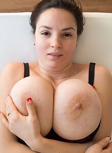 Black-haired amateur shows off her huge natural boobs